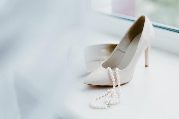 Female wedding footwear with pearls