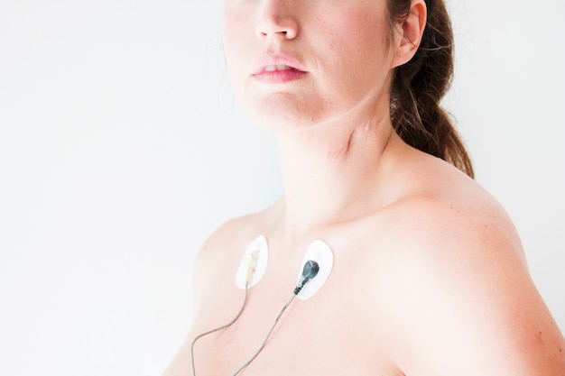 Female with electrocardiogram leads on body