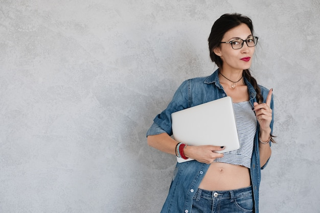 Female with laptop on white