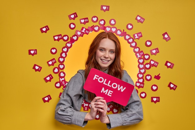Female with red hair ask to follow blog in internet, woman lead active life in social media