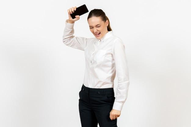 Female worker in elegant white blouse feeling angry on white