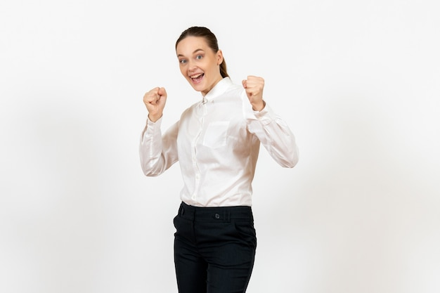 Female worker in elegant white blouse with excited face on white