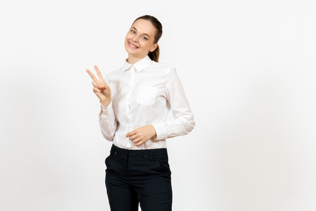 Female worker in elegant white blouse with happy face on white