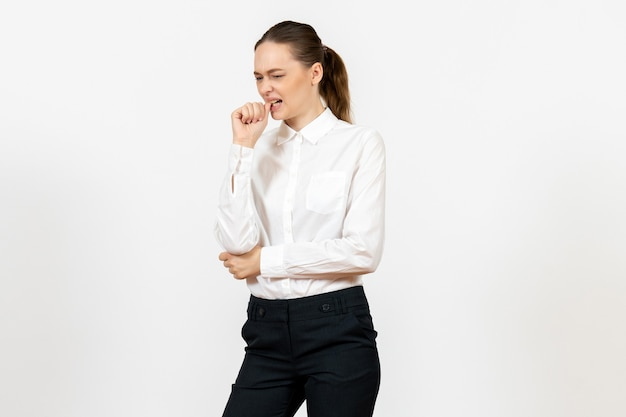 Female worker in elegant white blouse with nervous face on white