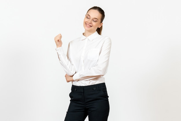 Female worker in elegant white blouse with smiling face on white
