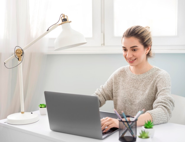 Female working on laptop from home