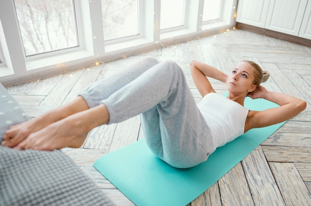 Female working out on mat