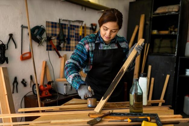 Female in workshop painting