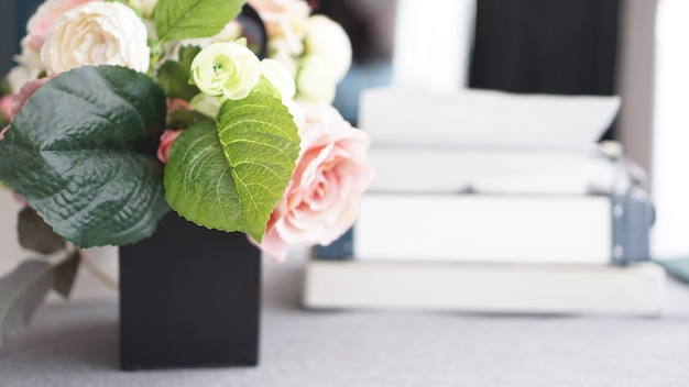 Female workspace with flowers bouquet on white background. womens office desk.