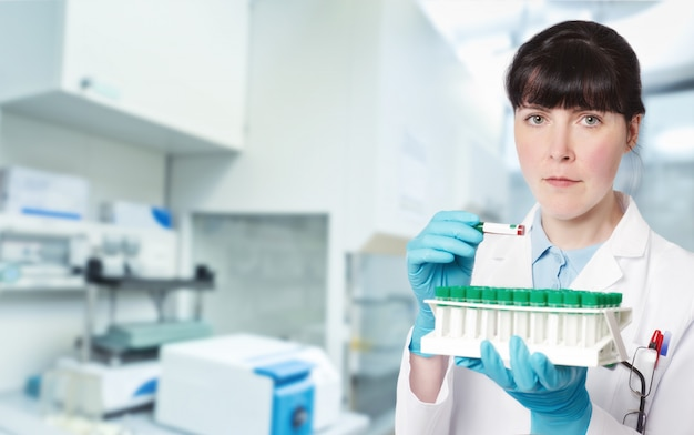 Female young doctor-intern, tech or a scientist in research facility