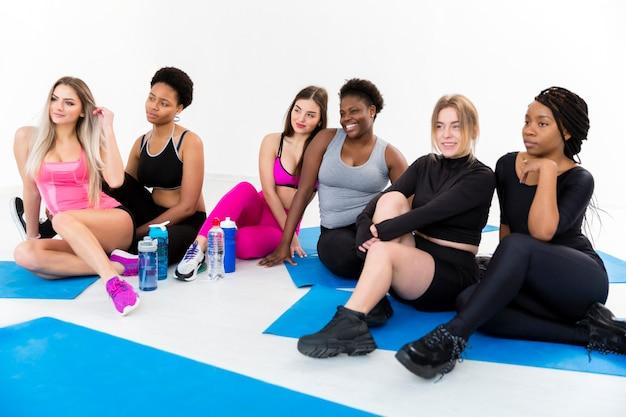 Females on mat having a break