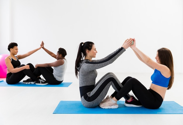 Females team work at fitness class