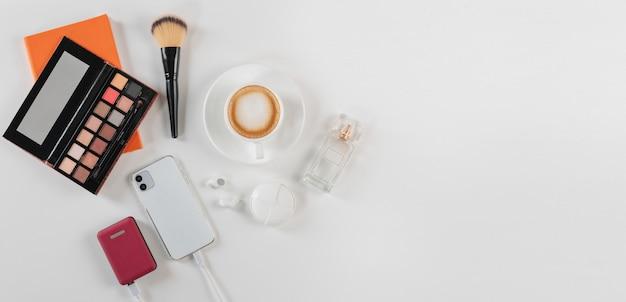 Feminine desk wokrspace with cosmetics