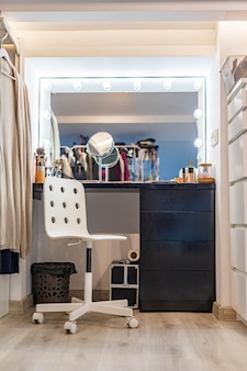 Feminine dressing table with lighting mirror cosmetics and accessories for getting ready beauty