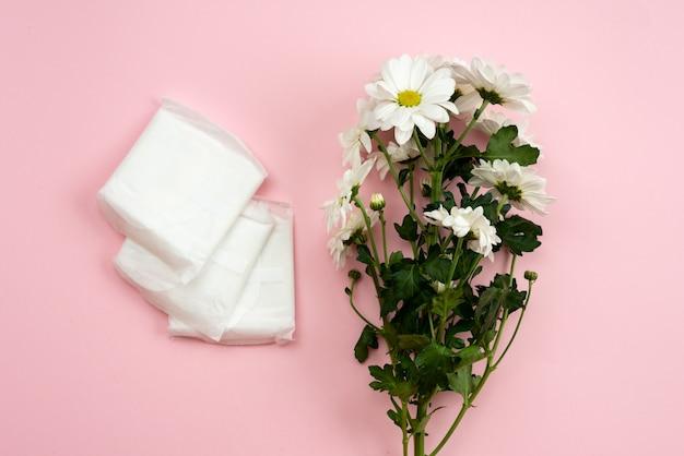 Feminine gasket for menstruation and white flower.