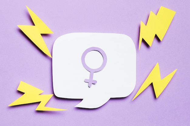 Feminine gender sign in speech bubble surrounded by thunders