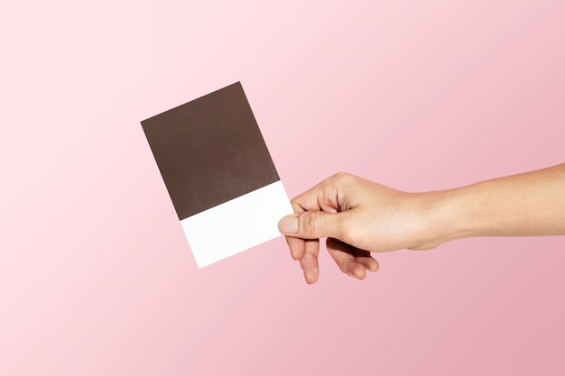 Feminine hand holding a color swatch