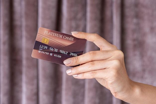 Feminine hand holding a credit card