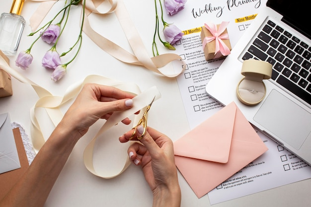 Feminine hands creating handmade invitations