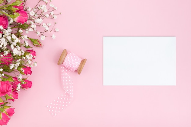 Feminine layout with blank card and floral bouquet