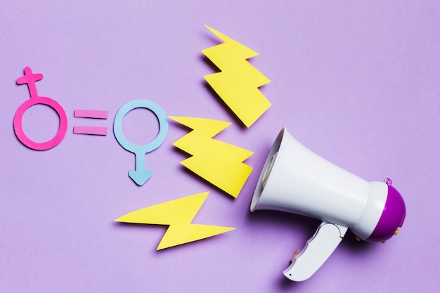 Feminine and masculine gender signs with thunder and megaphone