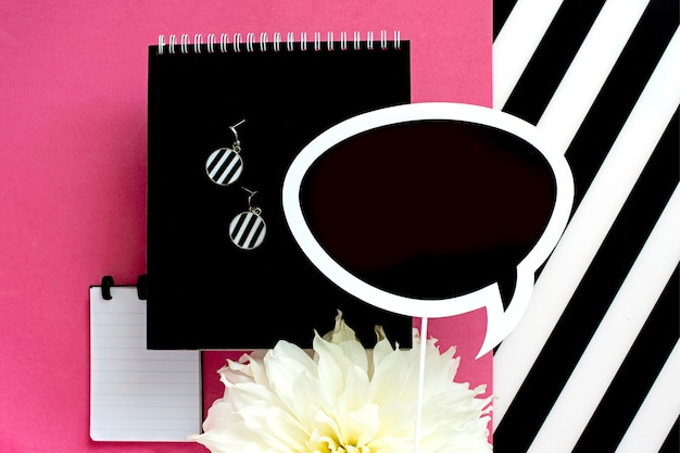 Feminine  office workspace with white and black striped paper blank. top view with copy space, flat lay.