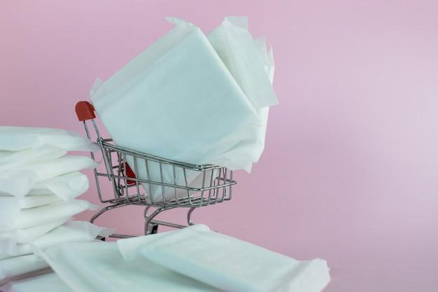Feminine sanitary napkin on pink background