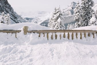 Fence covered with snow in mountains