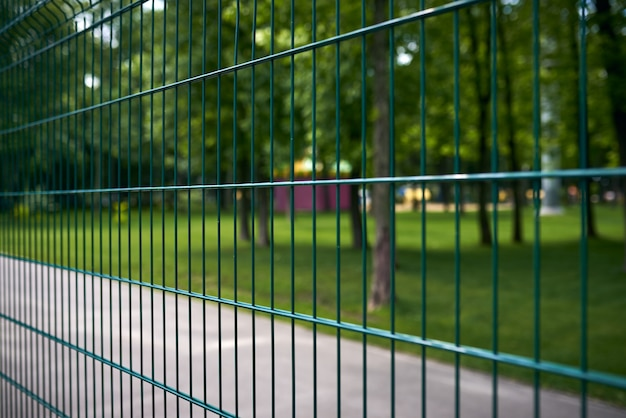 Fence at the public park at summer day