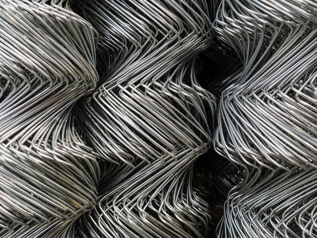 Fence rolls are made of galvanized steel mesh. large, twisted cells on the fence