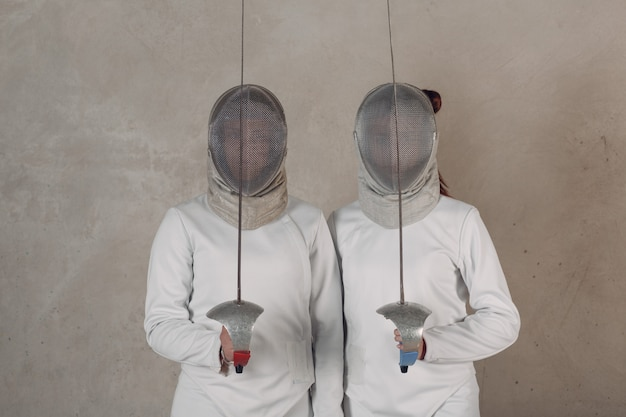 Fencer women with fencing sword.