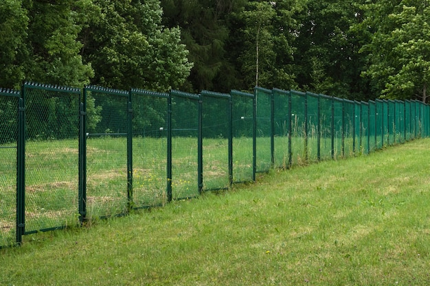 Fences with current on a green field