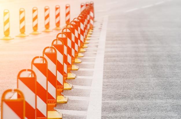 Fencing road signs on the road asphalt.