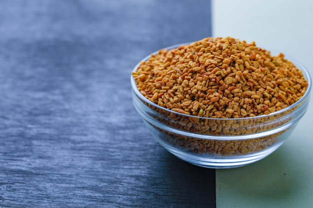 Fenugreek seeds in glass bowl