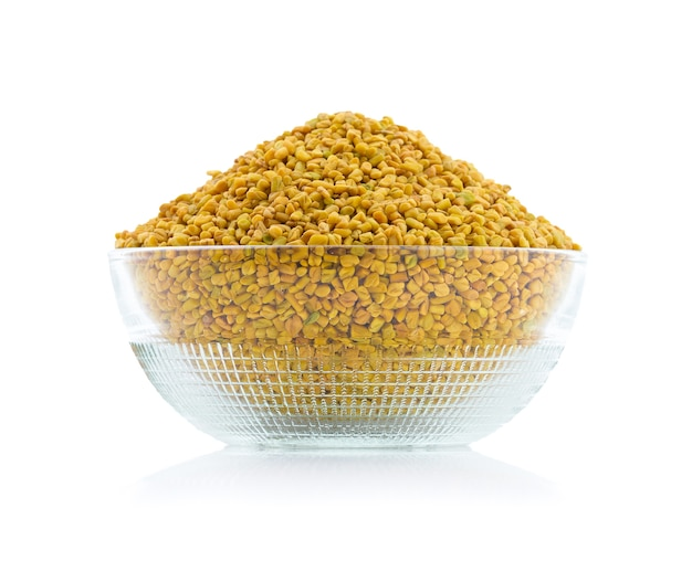 Fenugreek seeds or methi isolated on white background