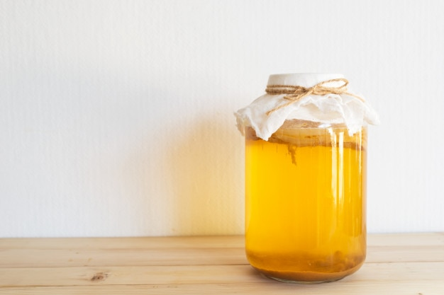 Fermented drink, jun tea healthy natural probiotic in a glass jar.