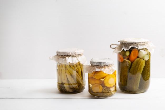 Fermented pickled vegetables in jars. marinated food.