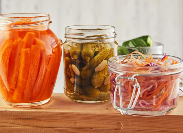Fermented preserved vegetarian food on wooden table