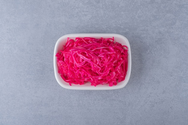Fermented red cabbage lies in bowl