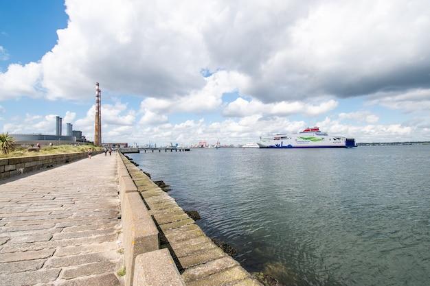 Ferries ship entering dublin harbour at poolbeg powerstation.