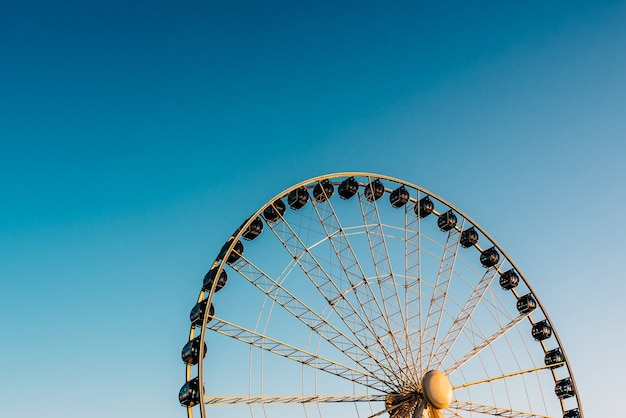 Ferris wheel against the blue sky in the port city gdynia poland