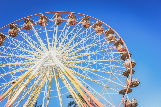 Ferris wheel in an amusement park at summer