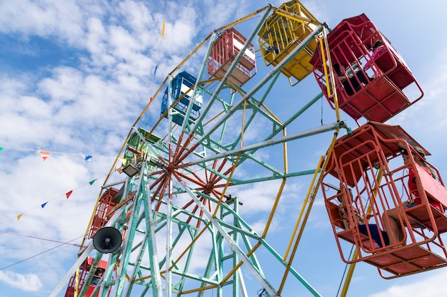 Ferris wheel in amusement park.