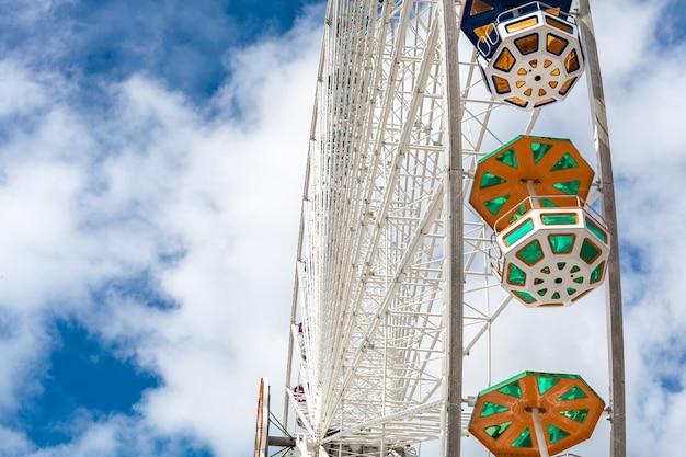Ferris wheel in an amusement parkblue sky
