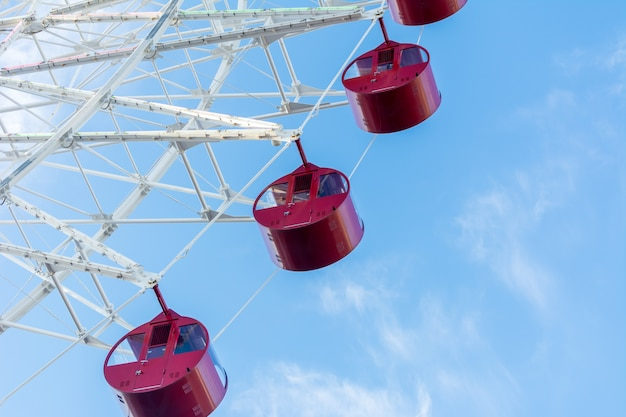 Ferris wheel on blue sky - closeup