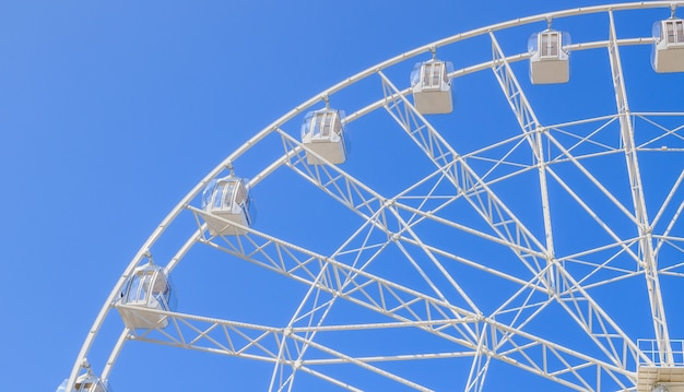 Ferris wheel in the blue sky. view the city from a height.