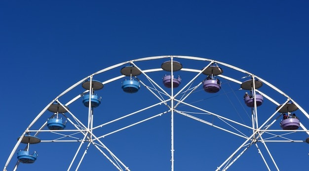 A ferris wheel in a blue sky