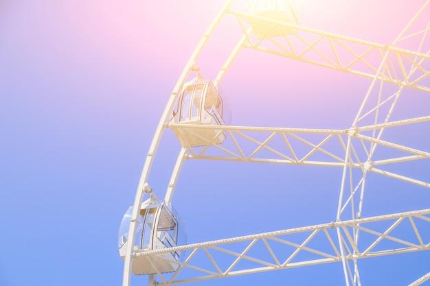 Ferris wheel in the blue sky.