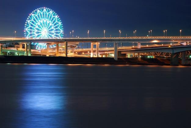 Ferris wheel over night water, tokyo