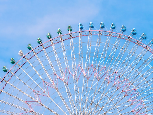 Ferris wheel in the park with blue sky background